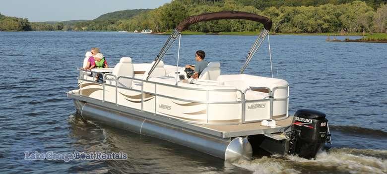 white pontoon boat on lake george