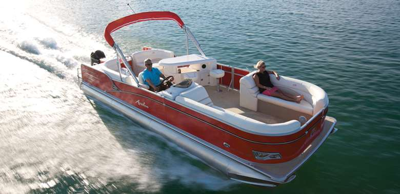 red pontoon boat on lake george