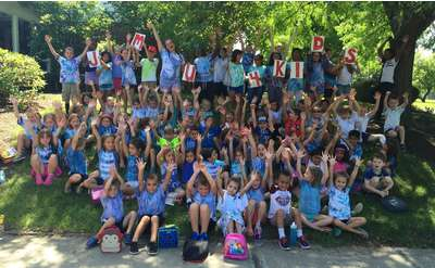 large group of summer camp kids outdoors for a group photo