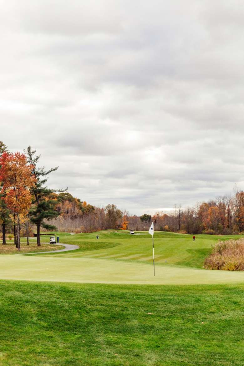 Golf pin in fall
