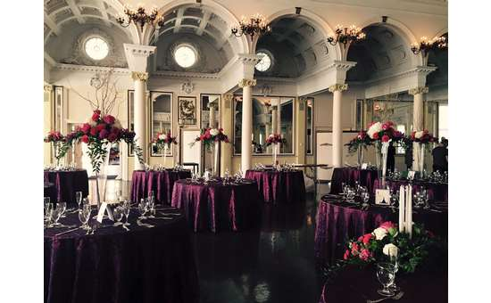 Flower bouquets on tables in a hall