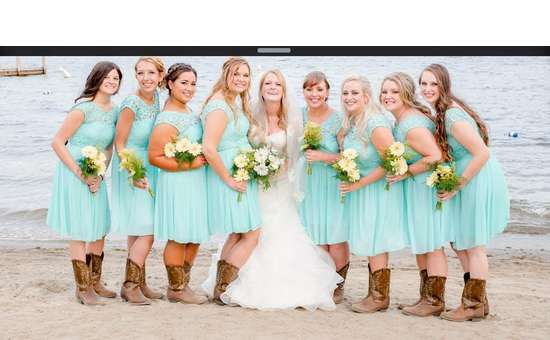 Bride and Bridesmaids standing on beach in cowboy boots