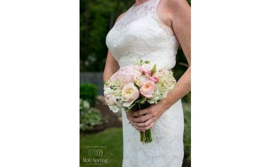 woman in Wedding dress and bouquet outdoors