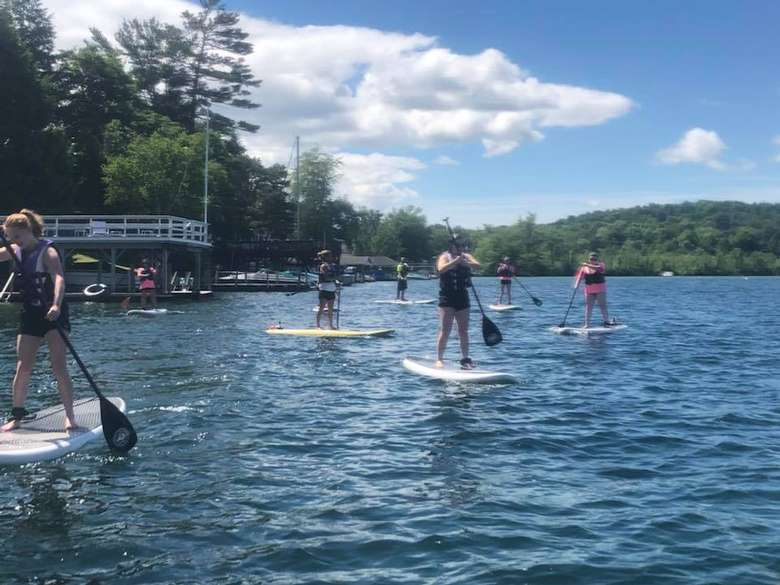 people on paddleboards