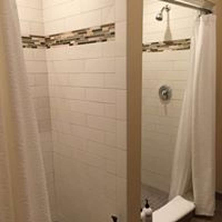 two tiled showers