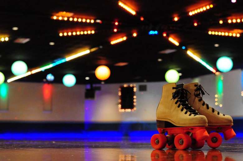 roller skates placed on rink