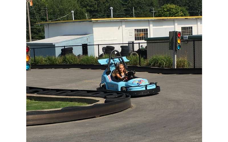 a young girl in a go-kart