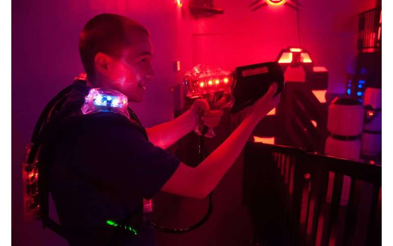 a boy playing laser tag