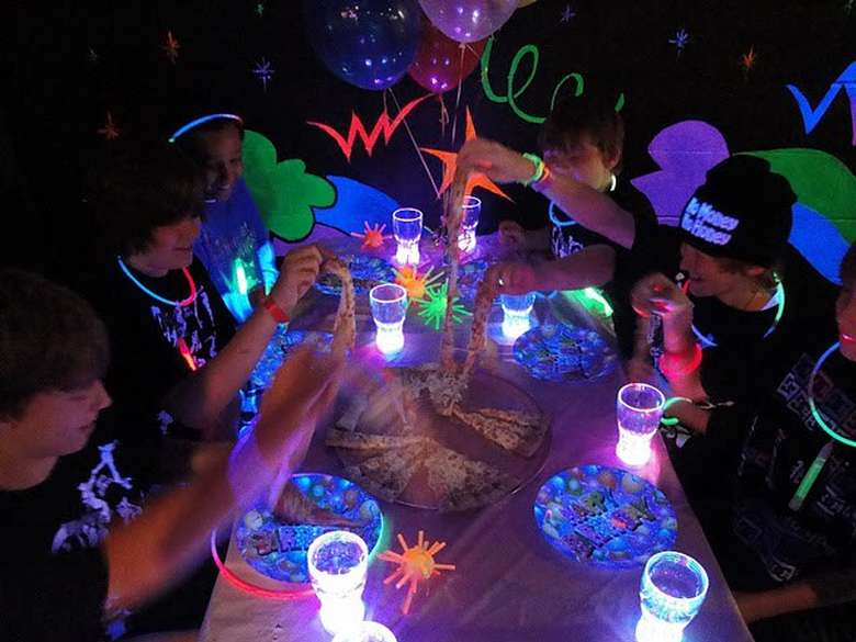 a birthday partying happening in blacklights