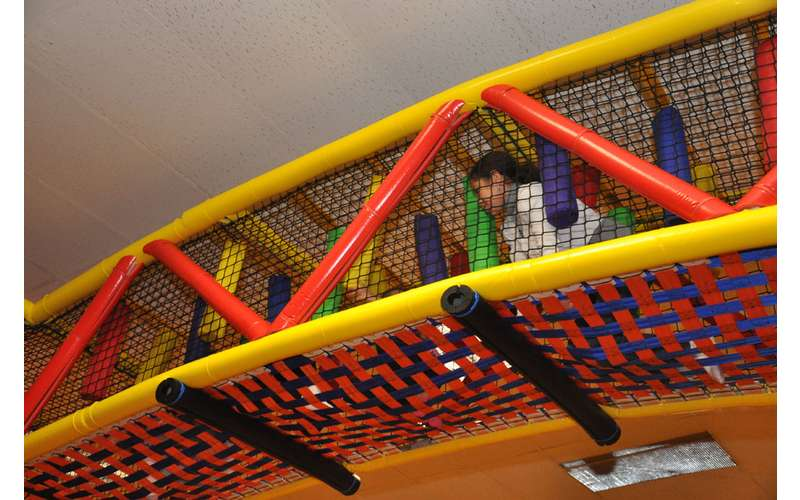 a kid playing in the indoor playground