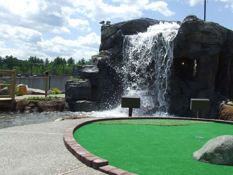 part of the golf course with a waterfall