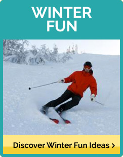 A downhill skier in a bright red jacket