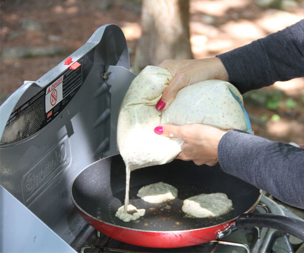 Making pancakes on the portable cooking stove