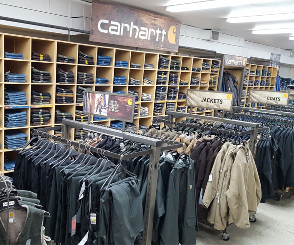 racks and shelves of carhartt clothing
