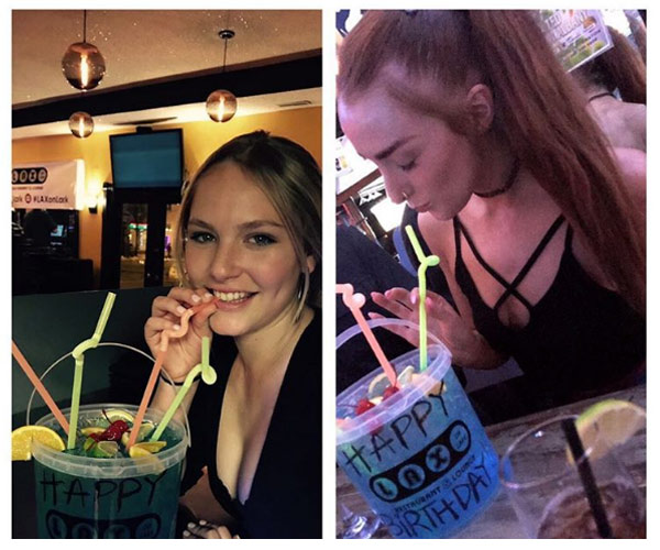 two girls drinking out of birthday buckets