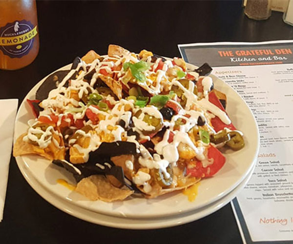plate of nachos and grateful den menu