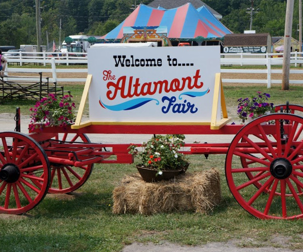 sign that says welcome to the altamont fair