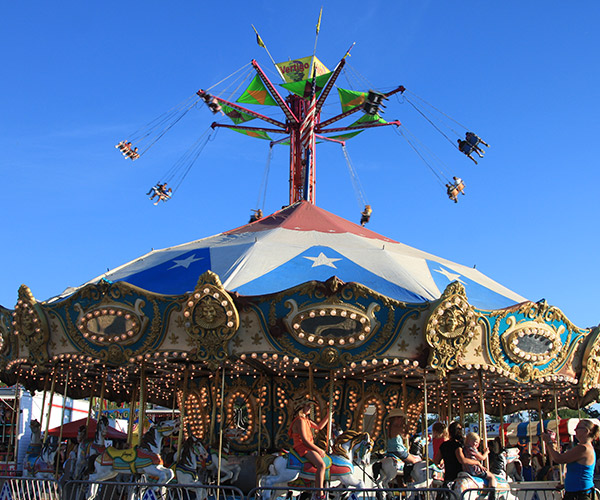 fair rides with blue sky