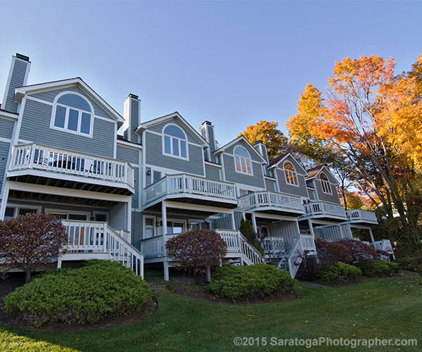 blue townhouses with fall foliage
