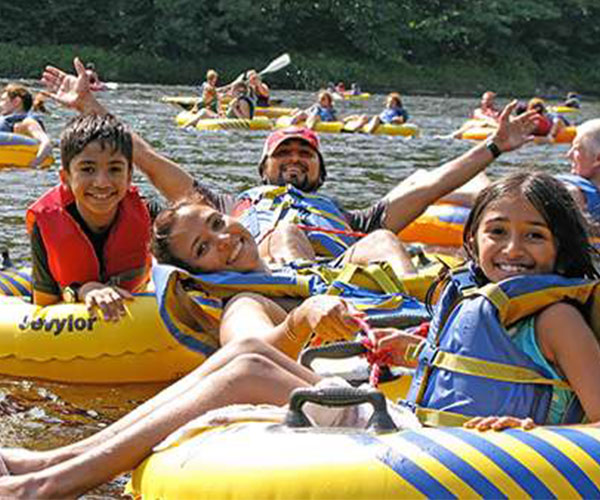 family tubing down a river