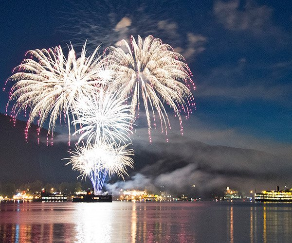 fireworks over lake george with steamboats lit up