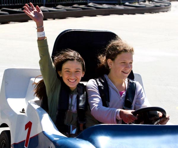 two girls in go karts