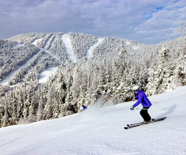 person skiing down Gore Mountain
