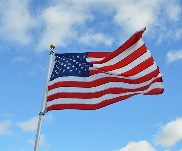 american flag on a sunny day