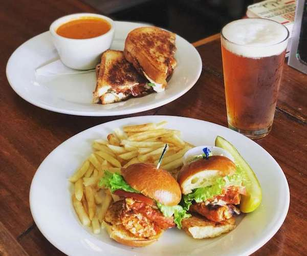 burger, beer, sandwich + soup on a table at McGeary's Irish Pub