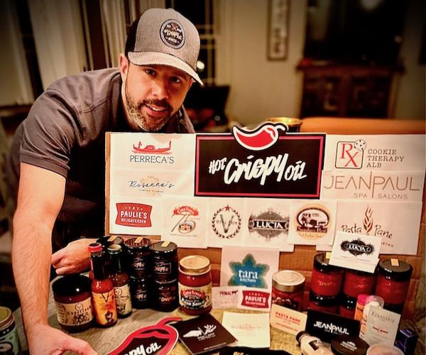 picture of giveaway items including gift cards from Capital Region restaurants and jars of food products