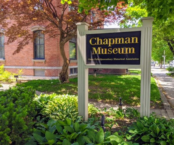 sign for the Chapman Museum in front of Chapman Museum building