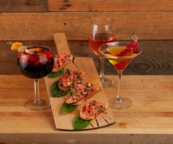cocktail glasses with bruschetta on a platter