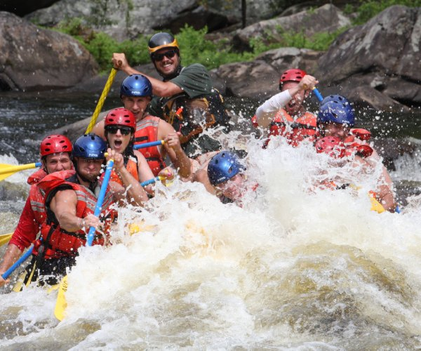 people on a whitewater rafting trip