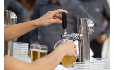 beer being poured into a cup