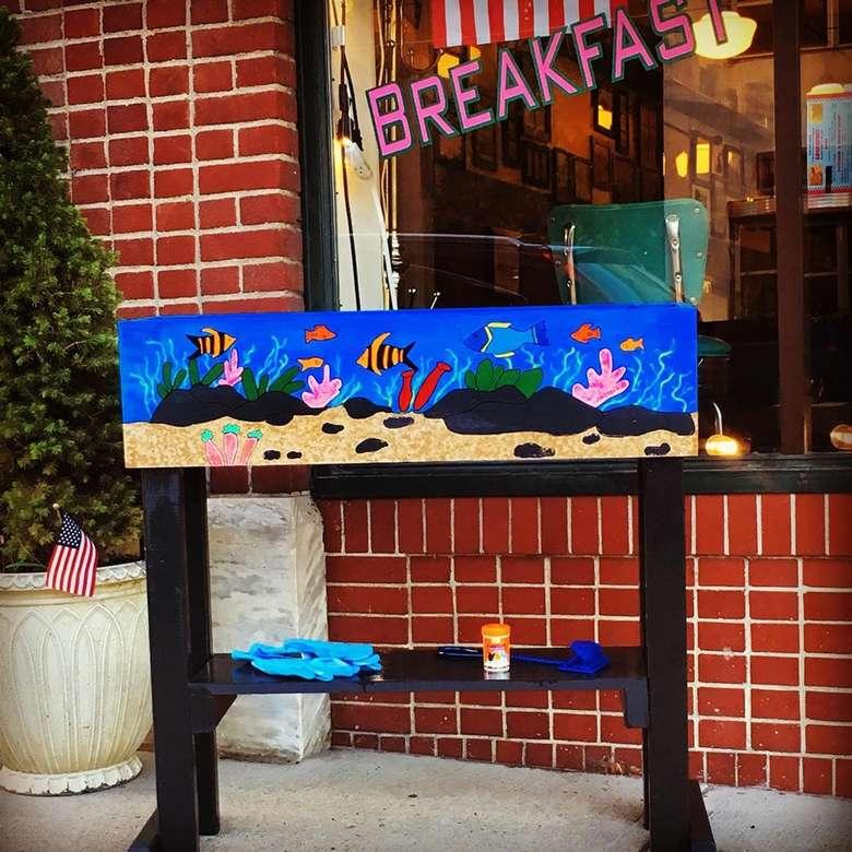 art in front of restaurant
