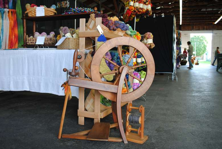 spinning wheel and colored yarn