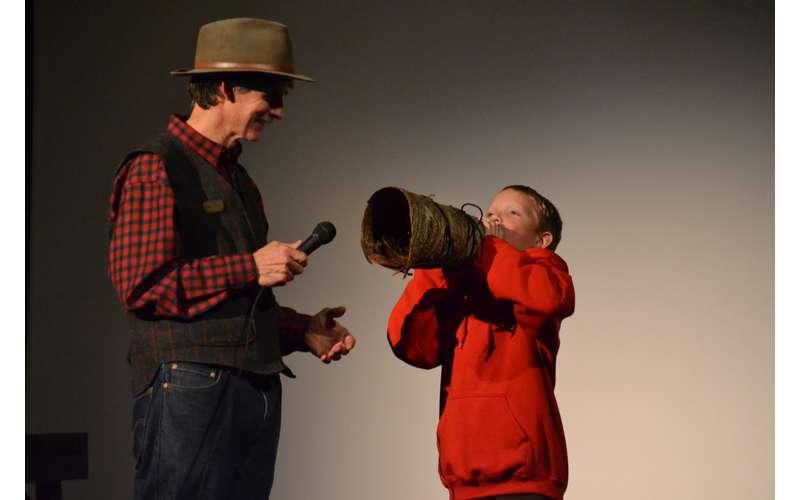 boy doing a moose call