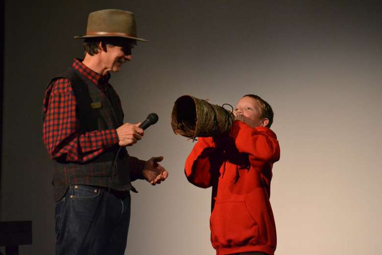 boy doing a moose call