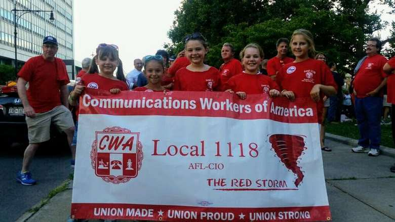 kids holding up Communications Workers of America banner