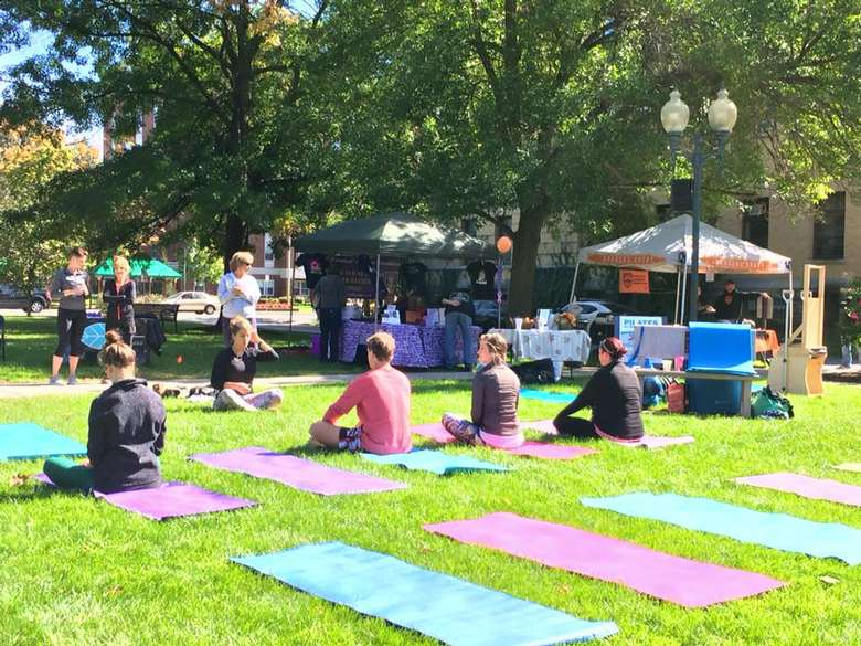 people on yoga mats in a park