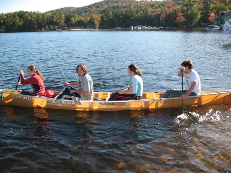 4 paddlers in a boat