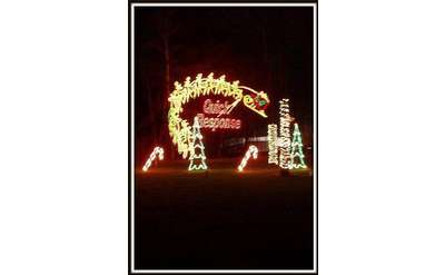 Quick Response spelled out in holiday lights with Santa and his reindeer