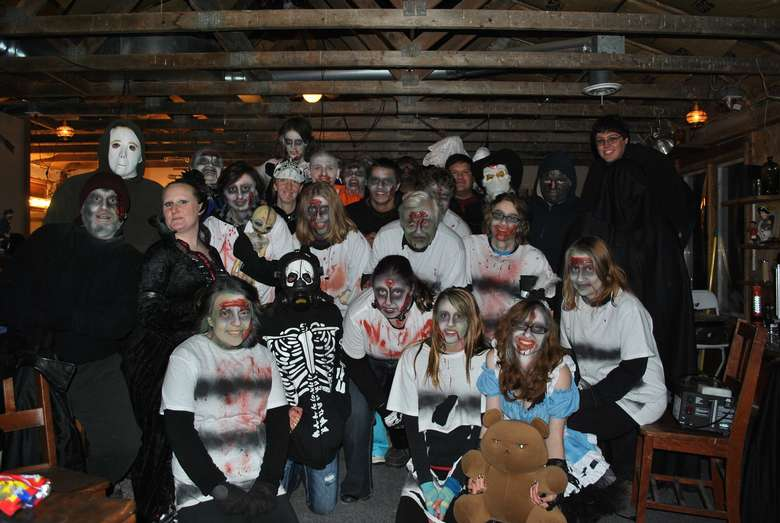 people dressed in a spooky haunted barn