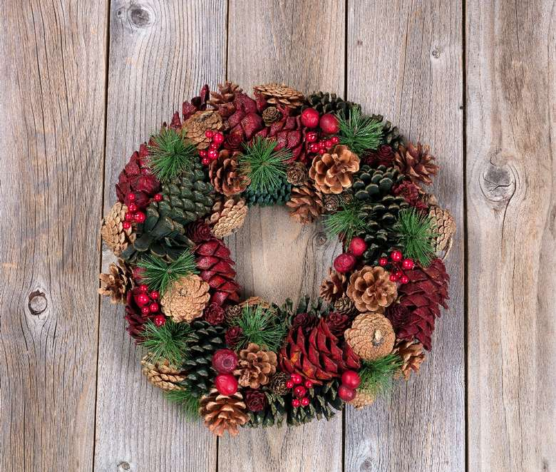 holiday wreath decorated with pinecones