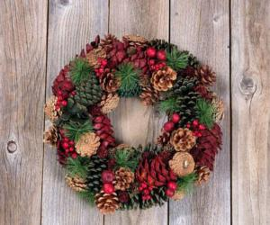 a festive wreath with pinecones