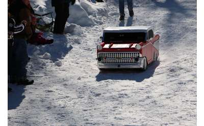a cardboard sled shaped like a car