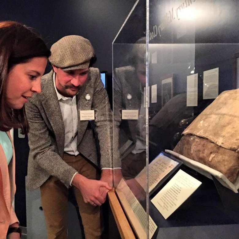 people examining an exhibit