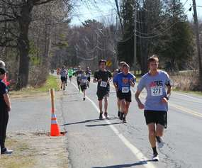 a line of runners on a road