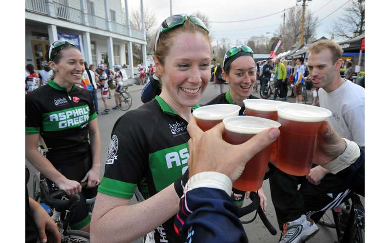 cyclists accepting beer