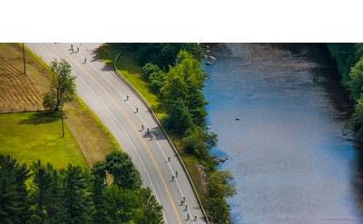aerial view of bikers next to a river